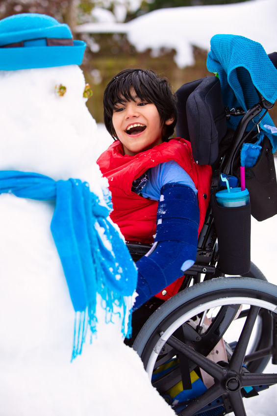 young boy with disability in wheelchair